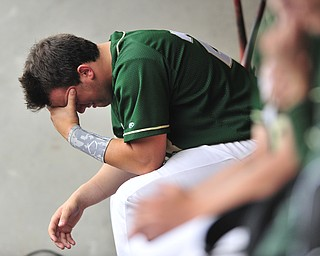 Michael Montallbano #23 of Ursuline reacts in the dugout after the first Wheelersburg run in the top of the 8th inning.