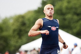 A member of the Austintown-Fich 4x200m relay team competes in the event at the state track and field finals at Jesse Owens Memorial Stadium, Columbus, OH, Saturday, July 8, 2013.