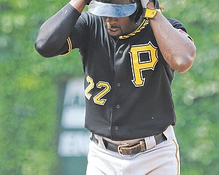 The Pirates' Andrew McCutchen reacts after being called out on a stolen base during the ninth inning of Sunday's baseball game against the Cubs in Chicago. The Cubs won 4-1.
