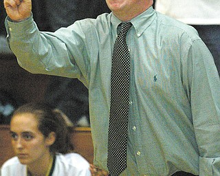 Ursuline girls basketball coach Sean Durkin signals to his girls during a 2004 game against Regina at Cuyahoga Falls. The Ursuline athletic director, Durkin will return as the Irish girls basketball coach.