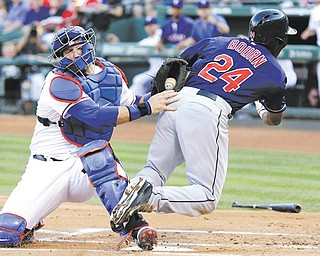 Rangers catcher A.J. Pierzynski, left, tags out Indians baserunner Michael Bourn at home plate during Cleveland's win on Wednesday in Arlington, Texas.