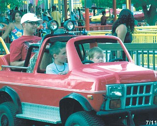Jason Hnat of Boardman is the backseat driver in this picture with his sons, Caleb and Colin, steering the ride at Cedar Point in Sandusky.