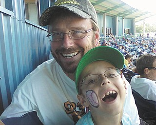 Mark Keil and his son Nikolaus, 9, share a fun day at a Scrappers  game last July. They live in Struthers.