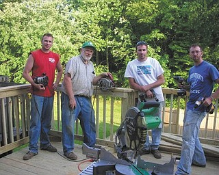 Bob Day of Berlin Center (second from left) took his sons (from left) Adam and Ryan, both of Austintown, to his son Eric's (right) home in Baltimore to build a new deck.