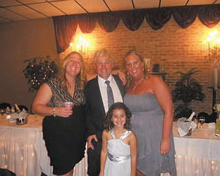 Paul Frankford of Girard is the fabulous dad in the middle, with daughters Amy Frankford of Warren and Julie Shaw of Boardman. Also in the picture is his granddaughter Jayna Shaw of Boardman.