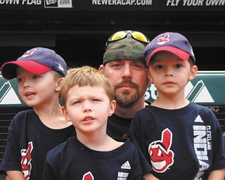 Jeremy Iftt is shown with his triplet sons, Brady, Talan and Maddox, who are celebrating their 7th birthday today! The picture was taken at a Cleveland Indians game last year. They live in Hubbard.
