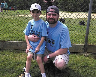 Nathan Richley, 6, is with his coach and father, Joseph Richley of Poland. Nathan plays baseball for the YMCA baseball league.