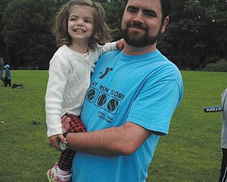 Joe Richley of Poland is with daughter Jocelyn, 2, at a recent baseball game at Rocky Ridge.