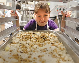 Robyn Mowrey, 14, of Canfield, places this dessert into a tray before it's placed in the oven for baking. Robyn participated in Mahoning County Career and Technical Center's Career Camp for sixth- through eighth-graders.