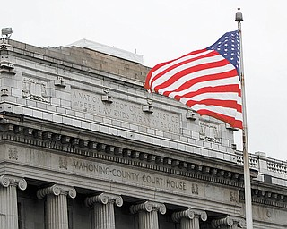 An American flag waves in the breeze in front of the Mahoning County Courthouse on Market Street in downtown Youngstown.