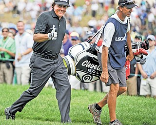 Phil Mickelson gives a thumbs up to spectators Thursday during Round 1 of the U.S. Open at Merion Golf Club's East Course in Ardmore, Pa. Mickelson overcame major obstacles including rain and jet lag to shoot a 67 and take a one-under lead.
