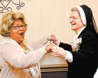 Sister Jerome Corcoran dances with Sophia Brooks at an event in Canfield to honor the nun. The Ethnic Heritage Society of Youngstown presented Sister Jerome with a lifetime achievement award Thursday evening.