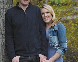 CHRISTOPHER J. MANN AND AMANDA J. HOMRIGHOUSE