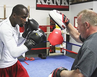 William D. Lewis\The Vindicator.Boxer Willie Nelson and trainer Jack Loew  during a 6-19-13 workout at Southside Boxing Club in Youngstown.