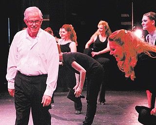 Tony Romeo walks off stage at Canfield High School Thursday night while his dancers give him a bow during his final dance recital after 58 years of teaching dance in the Valley.