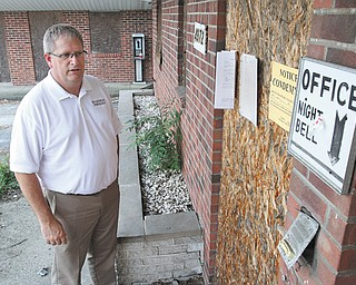 Boardman Township trustee Brad Calhoun gets a close look at the front entrance of the Terrace Motel, an eyesore on Market Street in the township that is finally coming down in July.