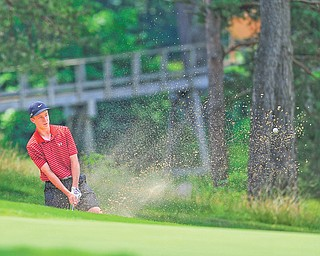 Nick Braydich of Mooney chips out of the sand trap and onto the green on the 18th hole at Monday's Greatest Golfer of the Valley junior qualifier at Salem Golf Club.