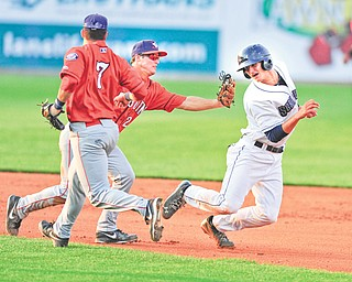 Scrappers baserunner Martin Cervenka, right, tries to avoid the tag of Doubledays infielder Cody Dent after being caught in a rundown in the fourth inning of Monday's game. Cervenka was eventually tagged out.