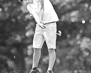 Matthew Popovich tees off on the 18th hole at the Salem Golf Club Monday afternoon.