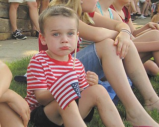 All decked out in red, white and blue; it's a tough job waiting for the parade to start. Submitted by Joyce Shaffer.