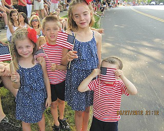 All smiles, or hiding, as the parade nears. Submitted by Joyce Shaffer.