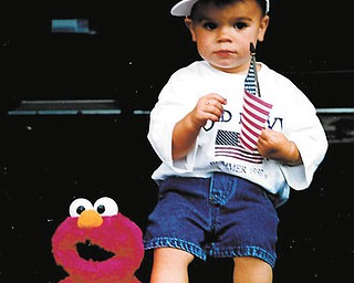 Corey Purcell of Dublin, Ohio, taken July 4, 1997. Corey graduated from high school June 8, 2013. Submitted by his grandmother, Janet Murray of Canfield.