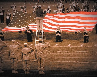 Heather Kesling  of Champion, took this photo at one of the high school football games this past season where a tribute was given to our military.