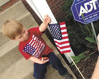 This is Cole Steiner planting a flag by the steps. He was two in this photo (12-31-10) and lives in North Canton, Ohio. His parents are Zak and Arin Steiner, originally from Girard and Champion. Sent by grandmother, Sharon Johnston of Austintown.