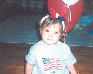 Molly Bury of Liberty, was one-year old when this photo was taken by her papa, Red Pallante of Liberty.