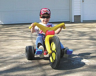 """Troy Sudimak, 4, is getting ready for the """"Firecracker 400"""" as he races at his grandparents, Rodney and Jeanne Sudimak's home."""