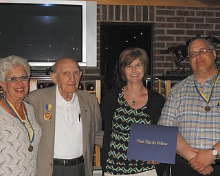 SPECIAL TO THE VINDICATOR The Struthers Rotary's annual presidents dinner recently celebrated the accomplishments of its members for the past year. Above are, from left, Mary Ann Morell and Paul Paris presenting the Paul Harris Fellow to Michelle Higgins and Tom Baringer, who received his second Paul Harris Fellow. Baringer recognized the following members: Anthony Quahliero, club service; Bryan Higgins and Mike Krake, community service; Linda Krestel and the Rev. Bob Bonnot, international service; Morell and Paris, vocational service; Mary Ann Kropinak, secretary; and Mike Evanson, treasurer. Krake also was awarded the Four Avenues of Service for 15 years of service. Jim Martin, president-elect, announced that Mike Evanson will continue as treasurer and Don Gabriele will be the new secretary.