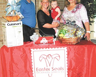 SPECIAL TO THE VINDICATOR Easter Seals eighth annual Auction at Margaritaville will take place at 6 p.m. July 19 at St. Michael Family Center in Canfield. Representatives of Easter Seals, above, are Ken Sklenar, president and chief executive officer; Jodi Harmon, development and personal relations director; Meredith Wakefield of Boardman, who attends the center and receives occupational and speech therapy; and Mary Ann Carano, chairwoman of the board of directors.