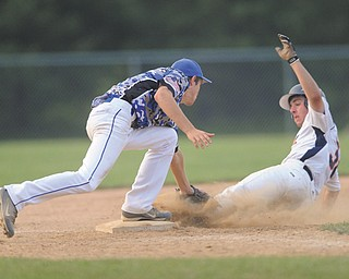 Astro Falcons baserunner Vinny Ruberto is tagged out by the Ohio Glaciers third baseman Evan Kendall. as he attempted to steal third during the bottom of the sixth inning in Game 2 of the Little b championship Tuesday at Cene Park in Struthers. The game was suspended for the second time in two days by lightning, with the Falcons leading the game at 6-4 and the series 1-0. Play resumes today at 8 p.m. on Cene 1, where Game 3 will follow, if necessary.