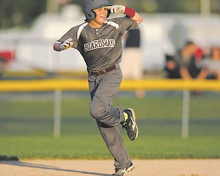 Boardman slugger Cameron Kreps salutes while trotting around the bases after hitting a two-run homer against Austintown. Boardman won, 16-3, to earn the Little League 11-12 district title.