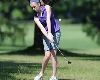 Sydney Heinbaugh of Youngstown chips out of the short rough and onto the green on the third hole Friday morning at Tamer Win in Cortland.