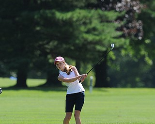 Nadya Stratton of Boardman chips her ball from the short rough and toward the green on the 8th hole Friday morning at Tamer Win in Cortland.