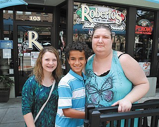 Helen Bond, a single mother of two, recently was diagnosed with acute renal failure. Family members and friends are planning a benefit dinner for Aug. 11 at the Holy Rosary Educational Center in Lowellville. Bond is shown above with her children, Alyssa Guerrieri, 14, and Dylan Bond, 11, in front of her uncle's downtown Youngstown restaurant, where Bond used to work.