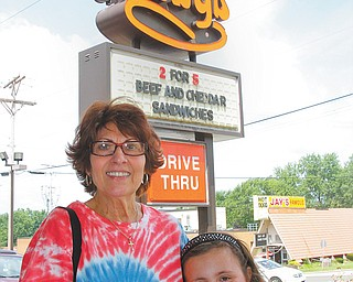 Joyce Masko and her granddaughter Jenna Billet were among the dozens who came to the Arby's in Boardman to take advantage of coupons for 64-cent regular roast-beef sandwiches. The fast food franchise began in Boardman on July 23, 1964.