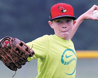 Dominic Pilolli warms up for the Canfield 10-11-year-old baseball team.
