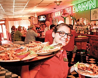 Golden Dawn server Anna Booth delivers a tray of Jumbo Burgers to the Burger Guyz.