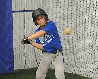 Mill Creek batter #17 Dominic Yozwiak swings at a pitch in the batting cage during practice Monday morning.