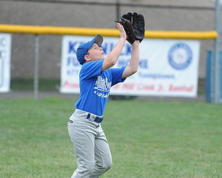 Mill Creek outfielder #8 Zachary Saunders gets under a fly ball during practice Monday morning.
