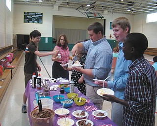 SPECIAL TO THE VINDICATOR St. Patrick School in Hubbard had its annual luncheon for seventh- and eighth-grade students. The luncheon is a tradition for students, who are treated to a catered lunch and an ice cream bar. The students socialize, sign yearbooks and have a Bequeaths ceremony. The graduating class leaves seventh-graders with words of wisdom and small tokens ranging from items in their lockers to thoughtful gifts for friends. From left are Daniel Strimbu, Mellony Leonard, Makenzie Pomeroy, Jeff Marx, Josh Chrobak and Guy Michel Kaho.