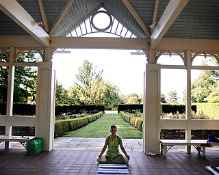 MADELYN P. HASTINGS   THE VINDICATOR  Karres Cvetkovich teaches a yoga class at the Fellows Riverside Gardens in Mill Creek Park on Thursday, July 25. Pilates and tai chi are also offered through the 'Scenic Fitness Workshop'.