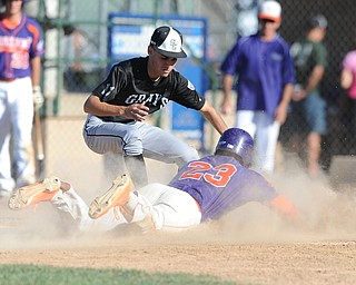 Creekside base runner #23 Santana Barrea slides into home plate to score a run on a passed ball, while Grays pitcher #11 Justin Galan misses the tag in the bottom of the 2nd inning.