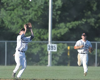 astro infielder #17 Brendan Cox gets under a fly ball for the out to end the inning. Teammate #20 Brenden Wells is behind him.
