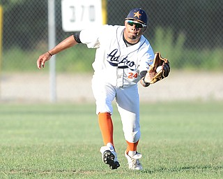 Astro outfielder #24 Keyshawn D'Orso catches a sinking fly ball in the outfield for the out.