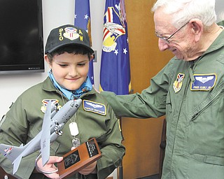 It was smiles all around as Nicholas Greathouse, 10, of Girard received a model of a C-130 cargo plane from Fred Kubli Jr. after the youth was sworn in as an honorary Air Force second lieutenant in the 910th Airlift Wing during Pilot for a Day activities Wednesday at the Youngstown Air Reserve Station in Vienna.