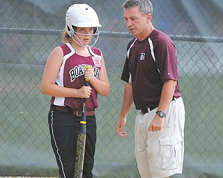 Jenna Burns of the Boardman 10-11 team gets some pointers from coach Brian Gorby before going up to bat during a Little League softball game last weekend at Springfi eld High School. Boardman will be making its second consecutive appearance at the state tournament Monday in Bucyrus.