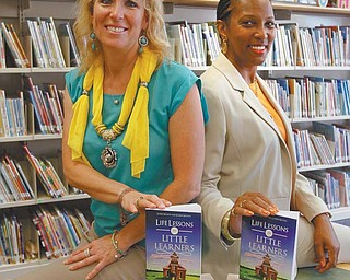 """Louise Mason, left, and Janine Motley wrote """"Life Lessons for Little Learners: Beginning Steps Toward Academic Success,"""" which will be in bookstores in September. Mason has been a teacher and principal for 28 years, now working in the Girard school district. Motley retired after 35 years with Liberty schools and three years at Youngstown State University."""